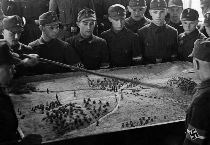 "Contemporary | National Socialist Flyers Corps and NSKK | Hitler Youth training at ""sand table"", 1940 