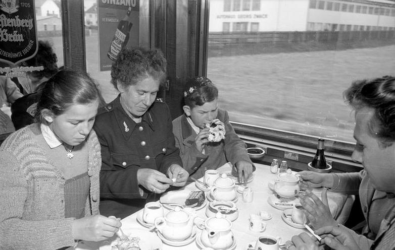 Daily Life | The 1960s | Rail traveller in the dining car of an interzonal train, 1954 | 02286390