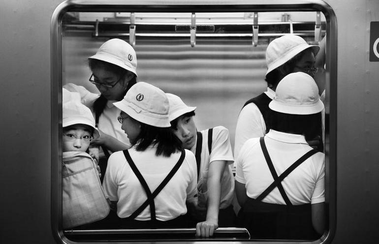 Places | Spain | Young women in school uniform in a metro, 2011 | 00781617